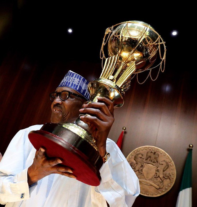 Amazing: President Buhari celebrates with D'Tigress, lift the championship Trophy